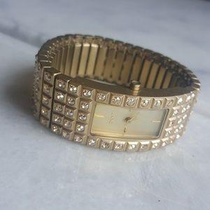 NWOT Rare DKNY Expandable Gold Glitz Watch